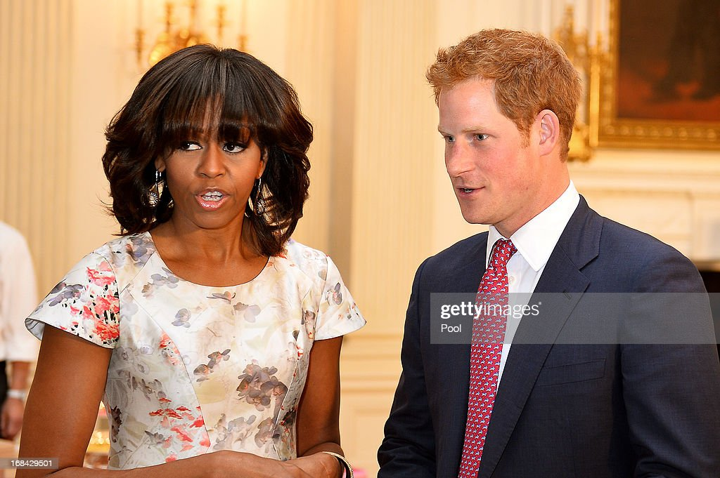 <a gi-track='captionPersonalityLinkClicked' href=/galleries/search?phrase=Prince+Harry&family=editorial&specificpeople=178173 ng-click='$event.stopPropagation()'>Prince Harry</a> and first lady <a gi-track='captionPersonalityLinkClicked' href=/galleries/search?phrase=Michelle+Obama&family=editorial&specificpeople=2528864 ng-click='$event.stopPropagation()'>Michelle Obama</a> meet at the White House during the first day of his visit to the United States on May 9, 2013 in Washington, DC. HRH will be undertaking engagements on behalf of charities with which the Prince is closely associated on behalf also of HM Government, with a central theme of supporting injured service personnel from the UK and US forces.