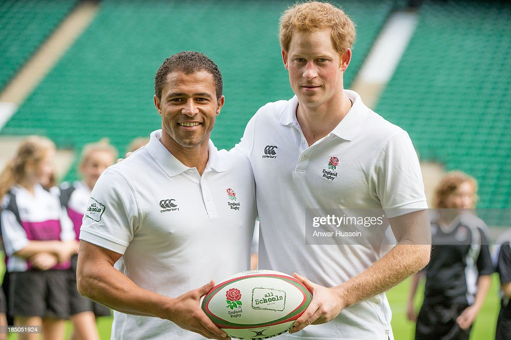 Prince Harry and former England International Jason Robinson pose with a rugby ball during the RFU All School Programme Coaching Event at Twickenham Stadium on October 17, 2013 in London, England.