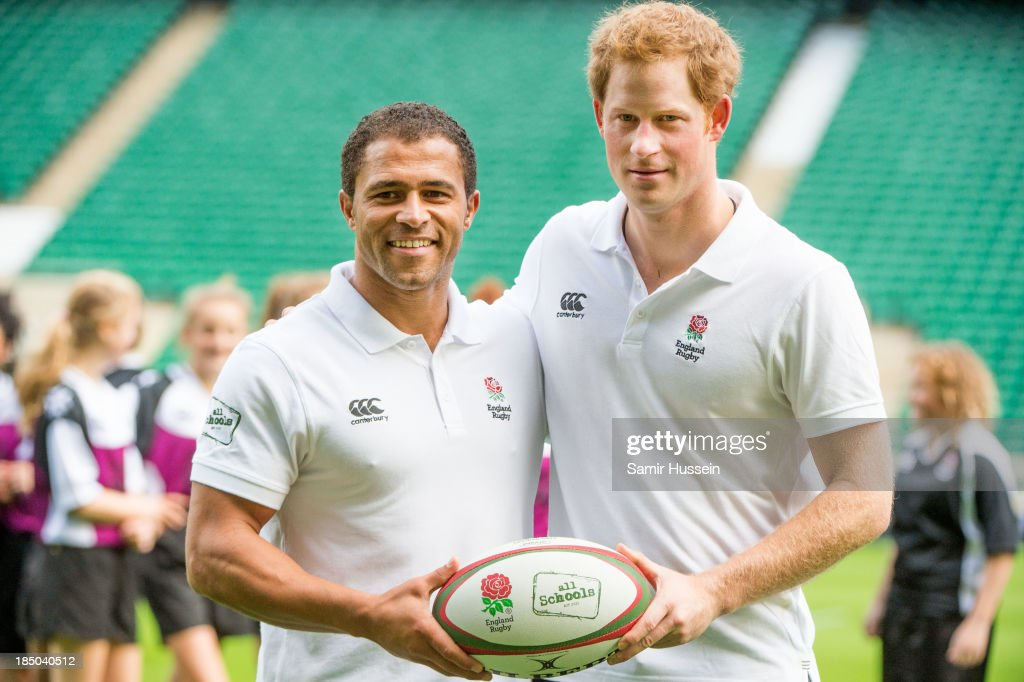 Prince Harry (R) and former England international Jason Robinson pose together at the RFU All School Programme Coaching Event at Twickenham Stadium on October 17, 2013 in London, England.