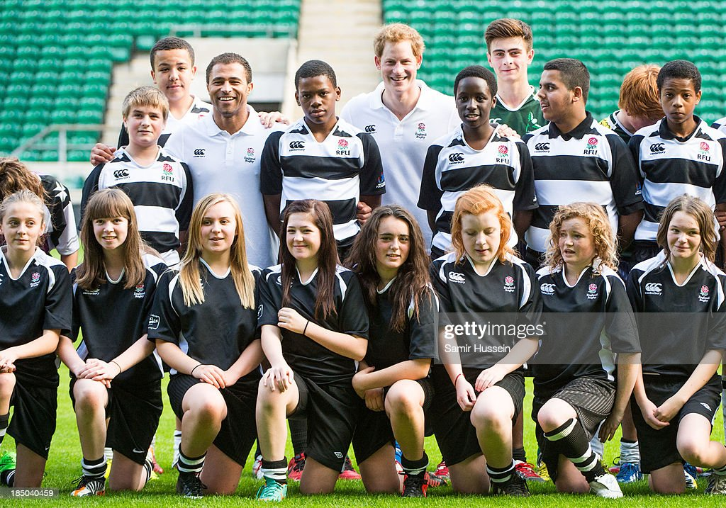 Prince Harry and former England international Jason Robinson (3rd L) pose for a team photo at the RFU All School Programme Coaching Event at Twickenham Stadium on October 17, 2013 in London, England.