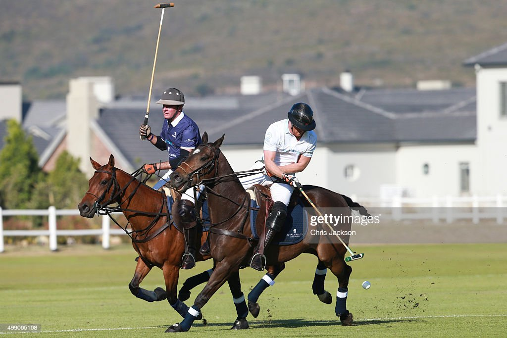 Prince Harry and Hannes Pickard in action the Sentebale Royal Salute Polo Cup at Val de Vie Estate on November 28 2015 in Paarl South Africa This is...