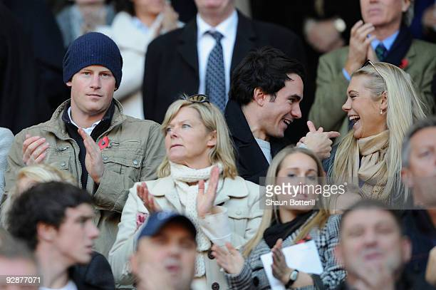 Prince Harry and his girlfriend Chelsy Davy look on during the Investec Challenge Series match between England and Australia at Twickenham on...