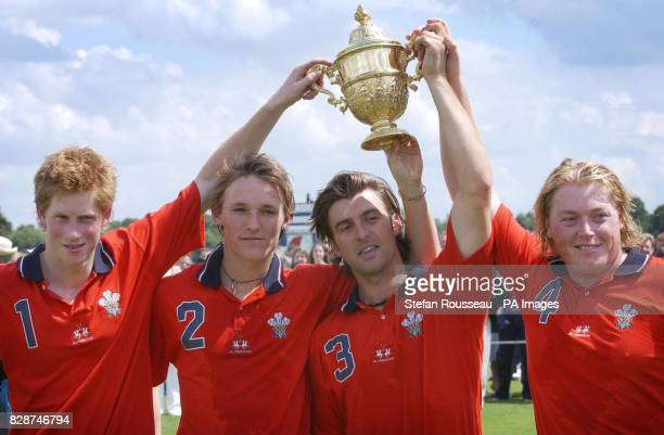 Prince Harry and his team mates collect the 'Golden Jubilee Cup' at Windsor Great Park after beating Hurlinghan