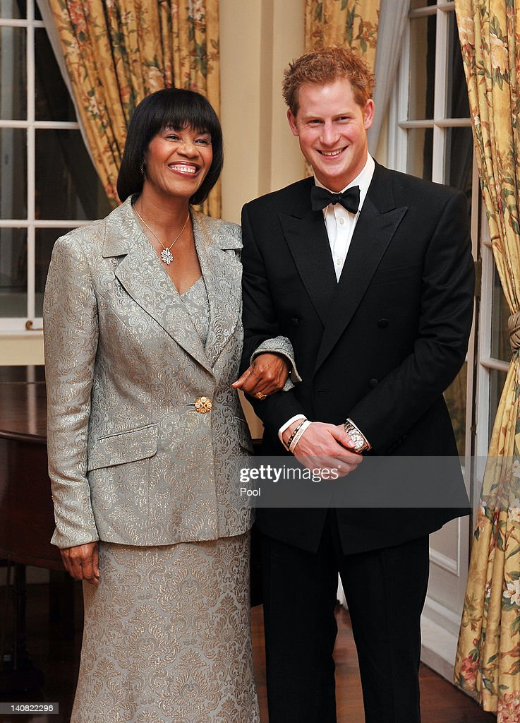 <a gi-track='captionPersonalityLinkClicked' href=/galleries/search?phrase=Prince+Harry&family=editorial&specificpeople=178173 ng-click='$event.stopPropagation()'>Prince Harry</a> and Jamaican Prime Minister Portia Simpson-Miller pose together at a reception before a state dinner in the King's House on March 6, 2012 in Kingston, Jamaica. <a gi-track='captionPersonalityLinkClicked' href=/galleries/search?phrase=Prince+Harry&family=editorial&specificpeople=178173 ng-click='$event.stopPropagation()'>Prince Harry</a> is in Jamaica as part of a Diamond Jubilee Tour, representing Queen Elizabeth II, taking in Belize, the Bahamas, Jamaica and Brazil.