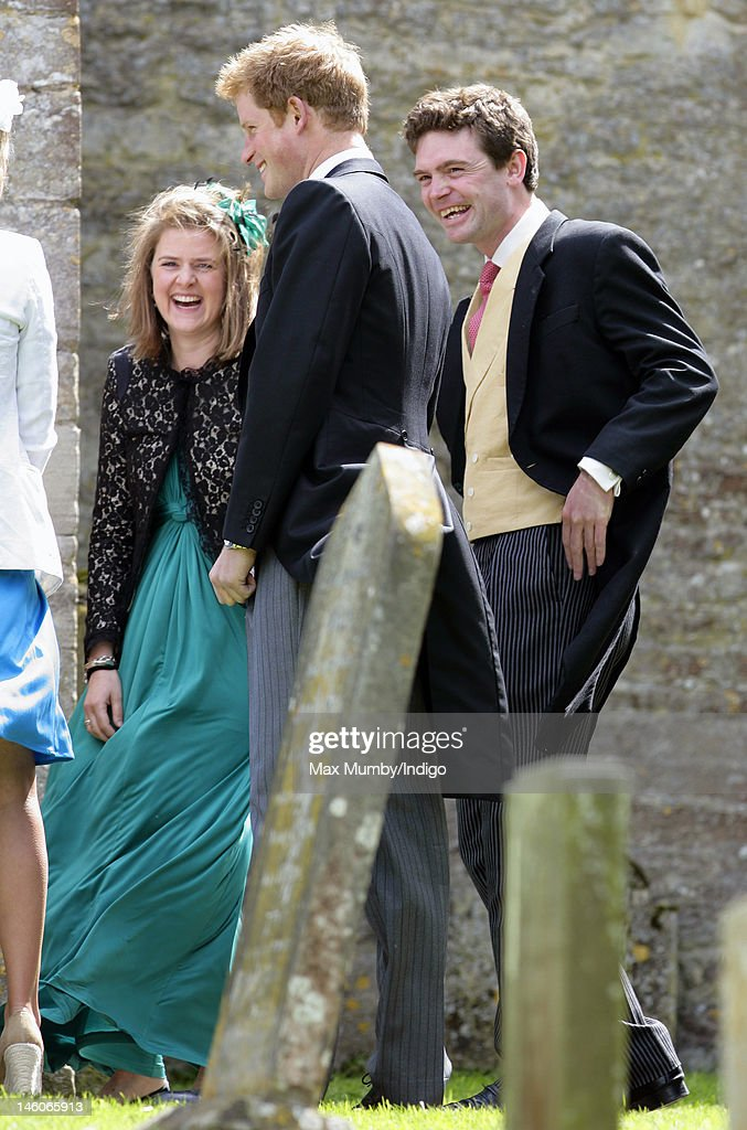Prince Harry and James Meade attend the wedding of Emily McCorquodale and James Hutt at The Church of St Andrew and St Mary, Stoke Rochford on June 9, 2012 in Grantham, England.