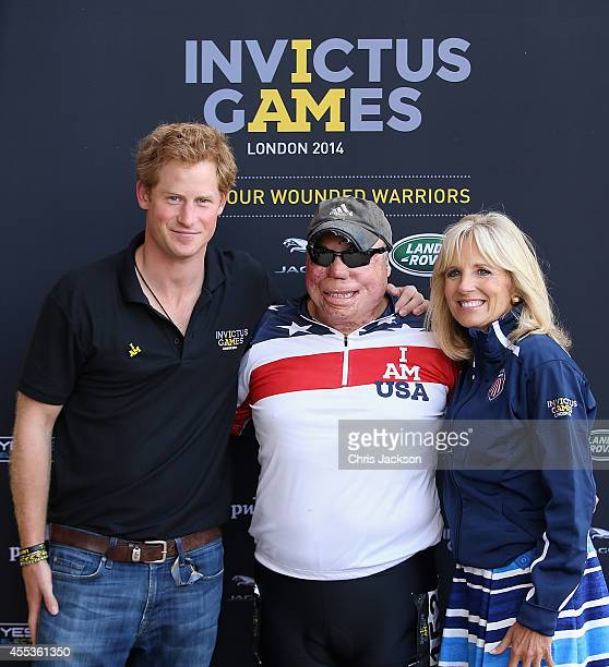 Prince Harry and Jill Biden pose with Israel Del Toro at the Velodrome at Queen Elizabeth park on September 13 2014 in London England The...
