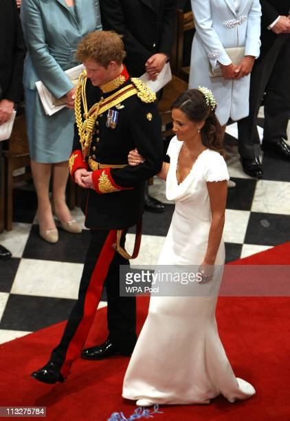 Prince Harry and Maid of Honour Pippa Middleton walk down the aisle at Westminster Abbey following the wedding ceremony of Prince William Duke of...
