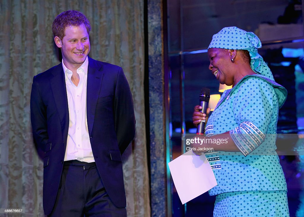 Prince Harry and Malineo Motsephe, who received the Service award on stage during the Sentebale Summer Party at the Dorchester Hotel on May 7, 2014 in London, England.