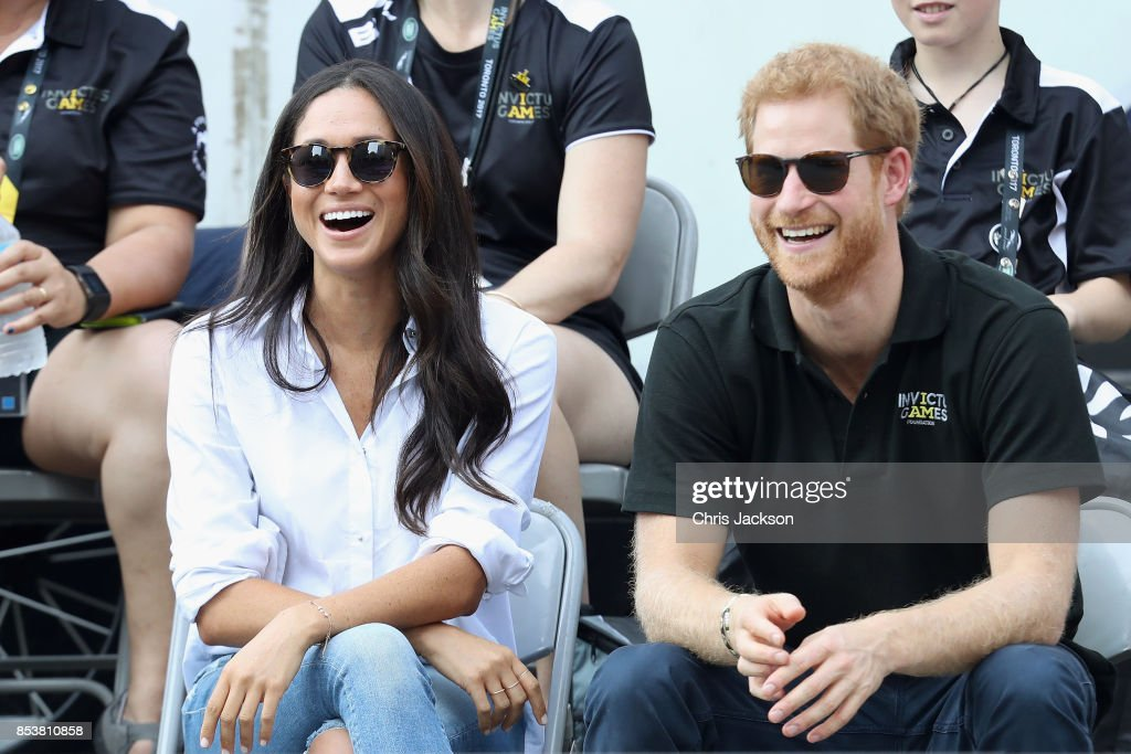 Prince Harry (R) and Meghan Markle (L) attend a Wheelchair Tennis match during the Invictus Games 2017 at Nathan Philips Square on September 25, 2017 in Toronto, Canada