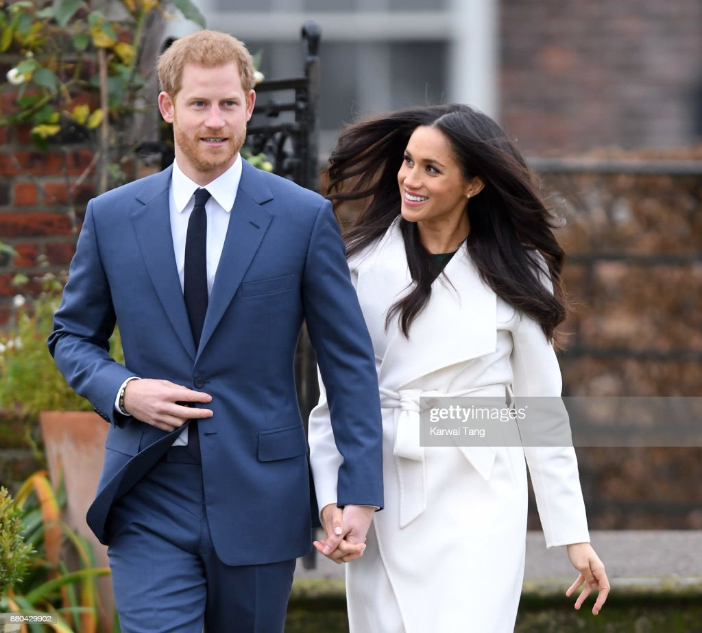 Prince Harry and Meghan Markle attend an official photocall to announce the engagement of Prince Harry and actress Meghan Markle at The Sunken Gardens at Kensington Palace on November 27, 2017 in London, England. Prince Harry and Meghan Markle have been a couple officially since November 2016 and are due to marry in Spring 2018.