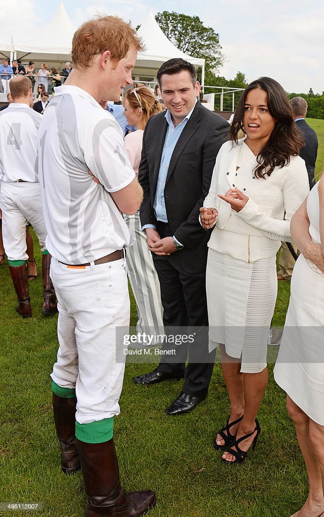 Prince Harry (L) and Michelle Rodriguez (R) attend day two of the Audi Polo Challenge at Coworth Park Polo Club on June 1, 2014 in Ascot, England.