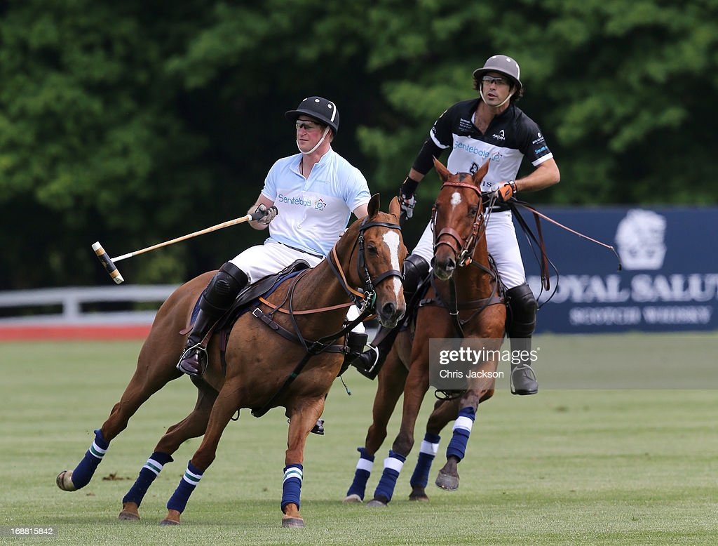 Prince Harry (L) and Nacho Figueras compete at the Greenwich Polo Club during the sixth day of HRH Prince Harry's visit to the United States. The Sentebale Royal Salute Polo Cup took place at Greenwich Polo Club on Wednesday 15th May. The Sentebale Land Rover team was captained by Royal Salute Ambassador Malcolm Borwick with team members Marc Ganzi, Michael Carrazza and Prince Harry, one of the founding Patrons of Sentebale. The St. Regis polo team was captained by Sentebale's Ambassador Nacho Figueras with team members Peter Orthwein, Steve Lefkowitz and Dawn Jones. Royal Salute played host to a number of high profile celebrities including His Grace Torquhil Ian Campbell, the 13th Duke of Argyll, Karolina Kurkova and Olivia Palermo. Royal Salute World Polo is a global programme, which now supports tournaments across four continents. The luxury Scotch's involvement with Polo is founded on the game's incredible power, skill and elegance; qualities which blend perfectly with Royal Salute Scotch whisky, at Greenwich Polo Club on May 15, 2013 in Greenwich, Connecticut.