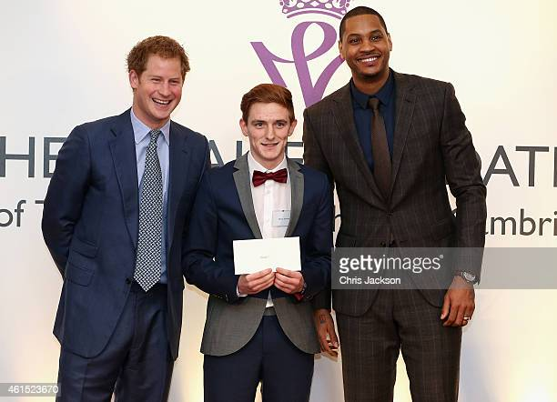 Prince Harry and NBA AllStar Carmelo Anthony present graduates with their certificates during a CoachCore Graduation event at St James's Palace on...