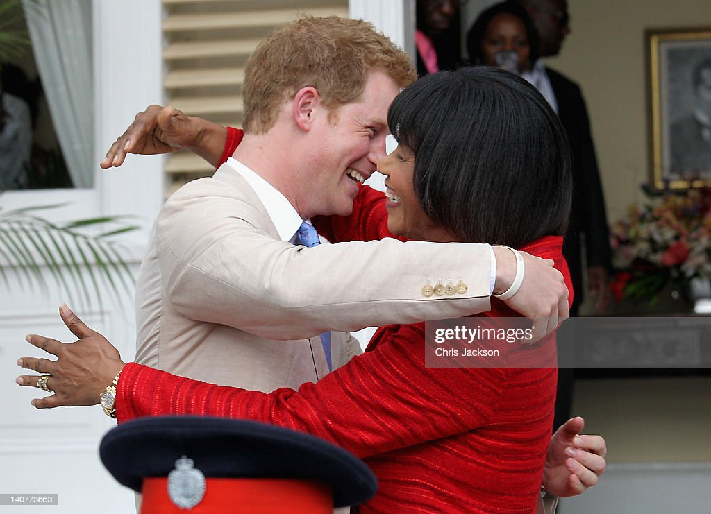 <a gi-track='captionPersonalityLinkClicked' href=/galleries/search?phrase=Prince+Harry&family=editorial&specificpeople=178173 ng-click='$event.stopPropagation()'>Prince Harry</a> and Prime Minister of Jamaica Portia Simpson-Miller hug on the steps of Devon House on March 6, 2012 in Kingston, Jamaica. <a gi-track='captionPersonalityLinkClicked' href=/galleries/search?phrase=Prince+Harry&family=editorial&specificpeople=178173 ng-click='$event.stopPropagation()'>Prince Harry</a> is in Jamaica as part of a Diamond Jubilee Tour, representing Queen Elizabeth II, taking in Belize, the Bahamas, Jamaica and Brazil.