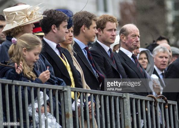 Prince Harry and Prince Edward Duke of Kent watch Queen Elizabeth II as she presents the Household Cavalry with new standards at Horse Guards Parade...