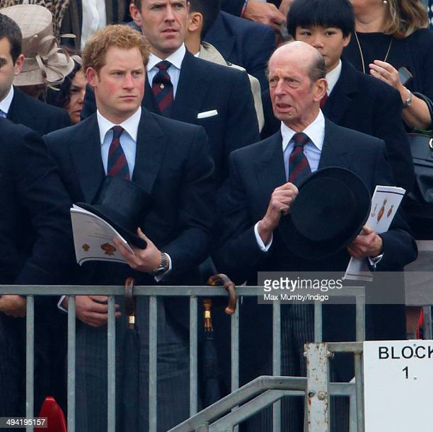 Prince Harry and Prince Edward Duke of Kent watch Queen Elizabeth II present new Standards to the Household Cavalry at Horse Guards Parade on May 28...
