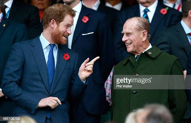 Prince Harry and Prince Phillip enjoy the atmosphere during the 2015 Rugby World Cup Final match between New Zealand and Australia at Twickenham...