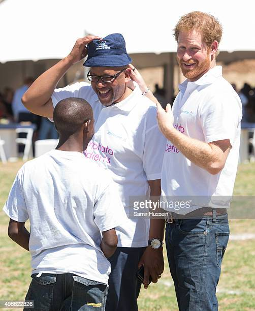 Prince Harry and Prince Seeiso of Lesotho greet a boy named Mutso as they attend the opening of Sentebale's Mamohato Children's Centre during an...