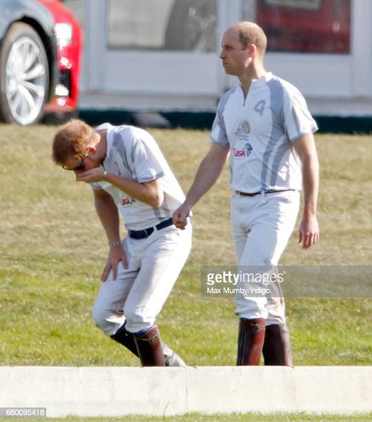 Prince Harry and Prince William Duke of Cambridge after taking part in the Audi Polo Challenge at Coworth Park Polo Club on May 7 2017 in Ascot...