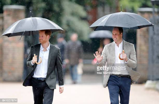 Prince Harry and Prince William Duke of Cambridge arrive to view tributes to Diana Princess of Wales left at the gates of Kensington Palace after...