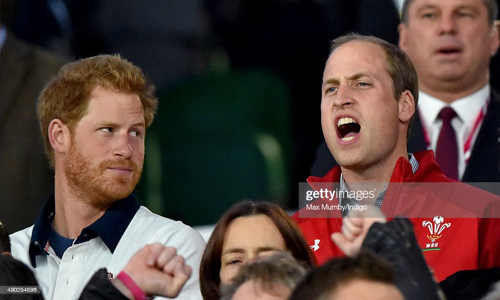 Prince Harry and Prince William Duke of Cambridge attend the England v Wales match during the Rugby World Cup 2015 at Twickenham Stadium on September...