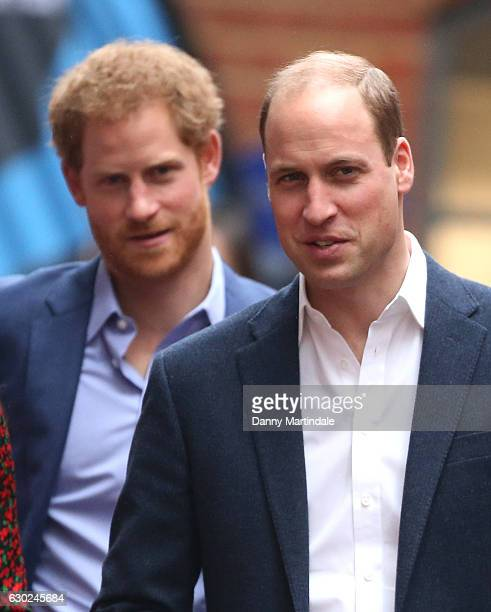 Prince Harry and Prince William Duke of Cambridge attends a Christmas party for volunteers at The Mix youth service on December 19 2016 in London...