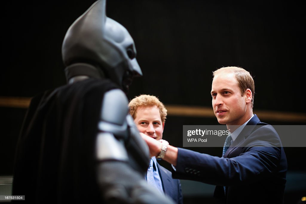 Prince Harry and Prince William, Duke of Cambridge inspect the Batman costume during the Inauguration Of Warner Bros. Studios Leavesden on April 26, 2013 in London, England.