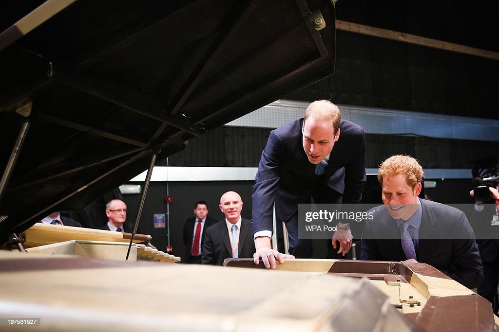 Prince Harry (R) and Prince William, Duke of Cambridge inspect the 'Tumbler', a vehicle used in the Batman films during the Inauguration Of Warner Bros. Studios Leavesden on April 26, 2013 in London, England.