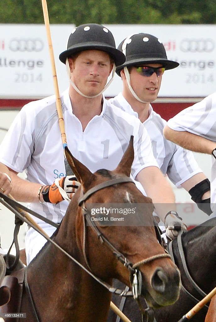 Prince Harry (L) and Prince William, Duke of Cambridge, play during day two of the Audi Polo Challenge at Coworth Park Polo Club on June 1, 2014 in Ascot, England.