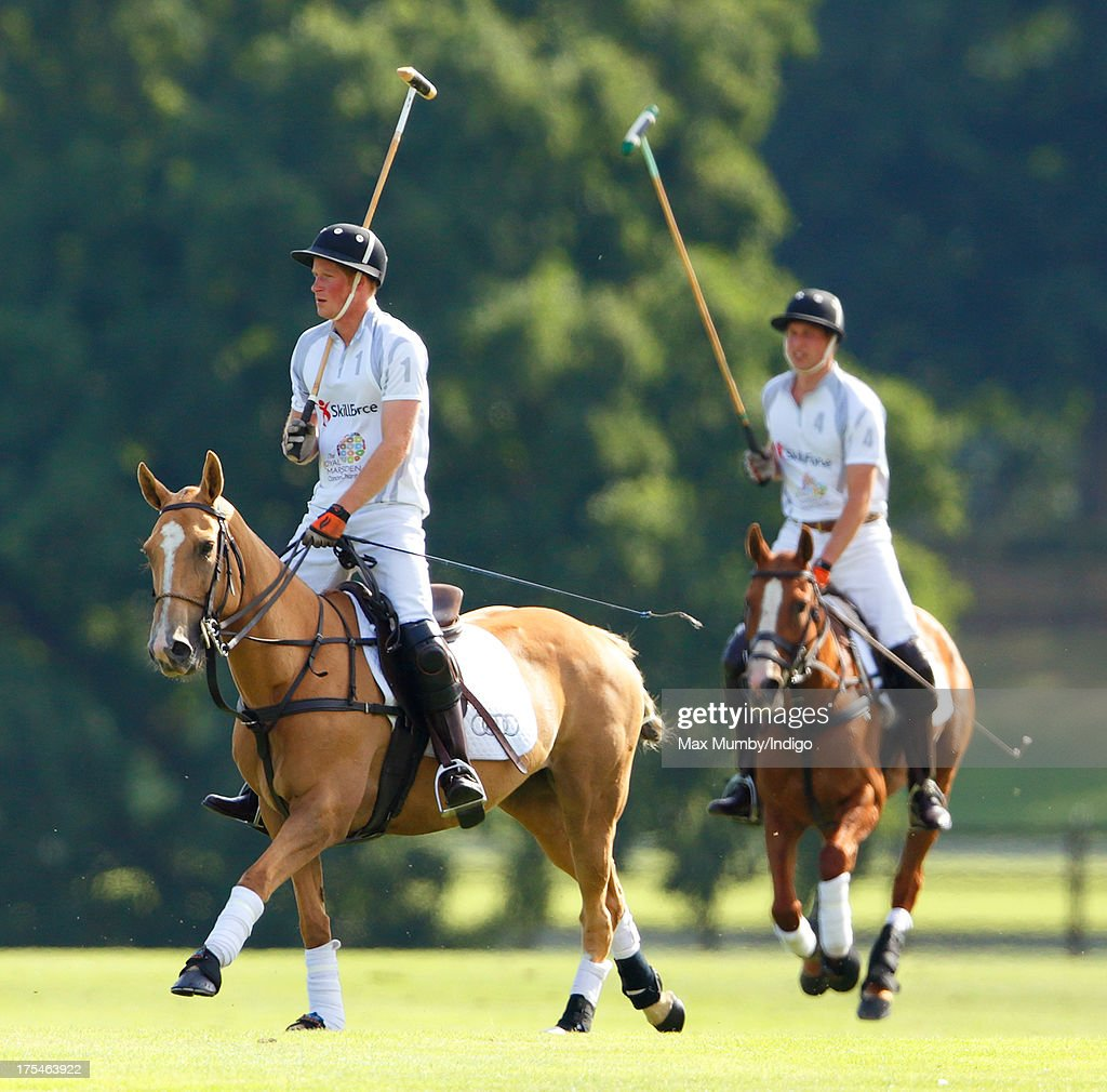 Prince Harry and Prince William, Duke of Cambridge play in the Audi Polo Challenge at Coworth Park Polo Club on August 3, 2013 in Ascot, England.