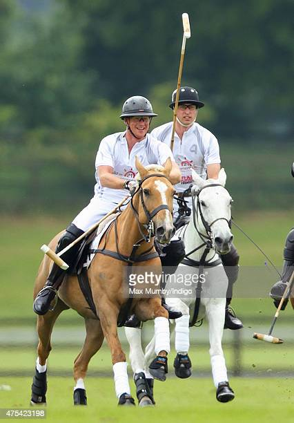Prince Harry and Prince William Duke of Cambridge play polo on day 2 of the Audi Polo Challenge at Coworth Park on May 31 2015 in Ascot England