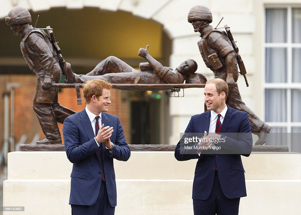 Prince Harry and Prince William, Duke of Cambridge stand in front of the Help for Heroes statue as they attend the opening of the new Help for Heroes Recovery Centre at Tedworth House on May 20, 2013 in Tidworth, England. During their visit the two Royal Princes met with wounded veterans, serving personnel, and their families. Tedworth House in Wiltshire is one of four new units in England which will offer respite care and rehabilitation to injured and sick service personnel, veterans and their families.