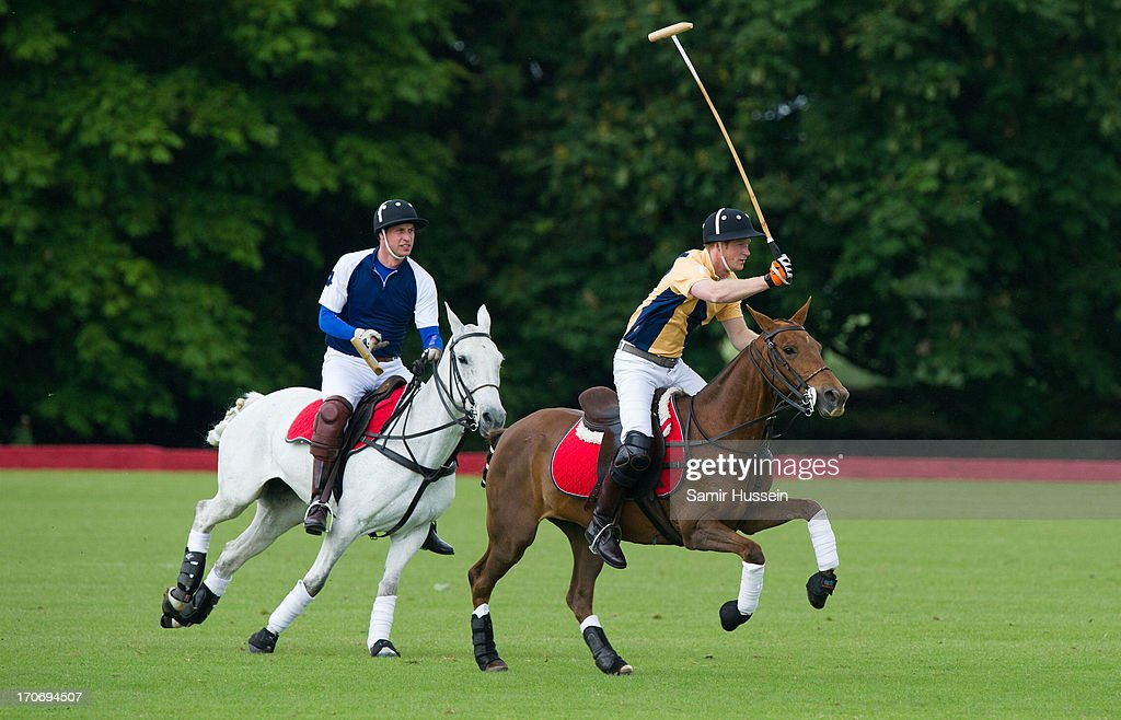 Prince Harry (R) and Prince William, Duke of Cambridge take part in a charity polo match at Beaufort Polo Club on June 16, 2013 in Tetbury, England.