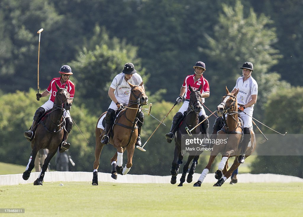 Prince Harry and Prince William, Duke of Cambridge take part in the Audi Polo Challenge at Coworth Park Polo Club on August 3, 2013 in Ascot, England.
