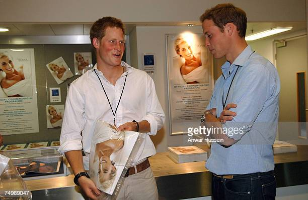 Prince Harry and Prince William inspect programmes prior to the Concert for Diana at Wembley Stadium on June 30 2007 in London England