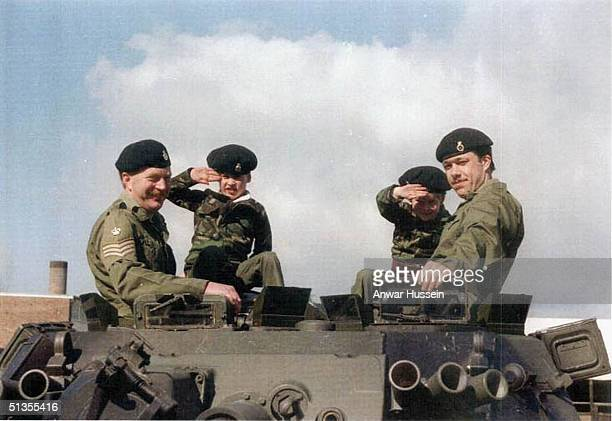 Prince Harry and Prince William sit on a tank dressed in combat fatigues whilst visiting Combermere Barracks in 1989 in Windsor England The young...