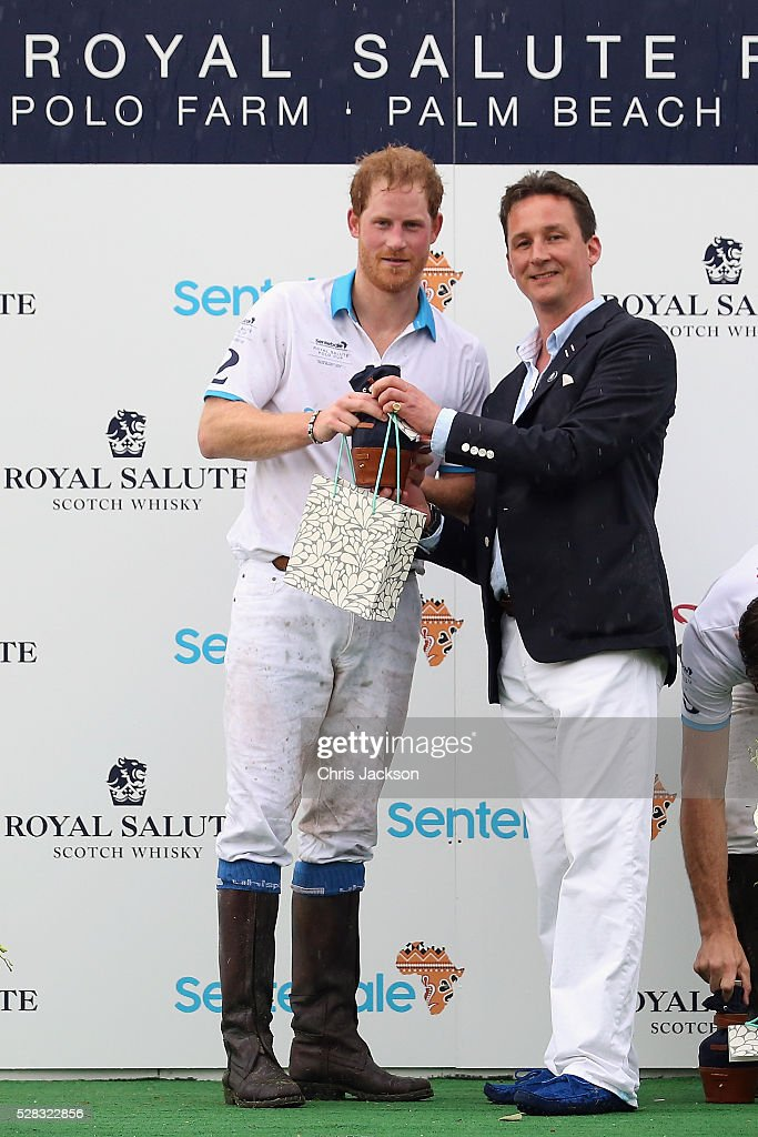 Prince Harry (L) and Royal Salute Brand Ambassador Torquhil Ian Campbell, 13th Duke of Argyll pose after the polo competition during the Sentebale Royal Salute Polo Cup in Palm Beach at Valiente Polo Farm on May 4, 2016 in Palm Beach, United. The event will raise money for Prince Harry's charity Sentebale, which supports vulnerable children and young people living with HIV in Lesotho in southern Africa.