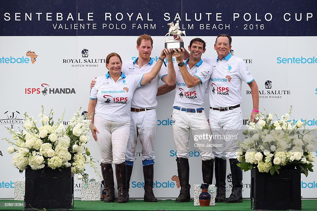 Prince Harry and Royal Salute World Polo Ambassador Malcolm Borwick pose with their team after competing during the Sentebale Royal Salute Polo Cup in Palm Beach at Valiente Polo Farm on May 4, 2016 in Palm Beach, United. The event will raise money for Prince Harry's charity Sentebale, which supports vulnerable children and young people living with HIV in Lesotho in southern Africa.