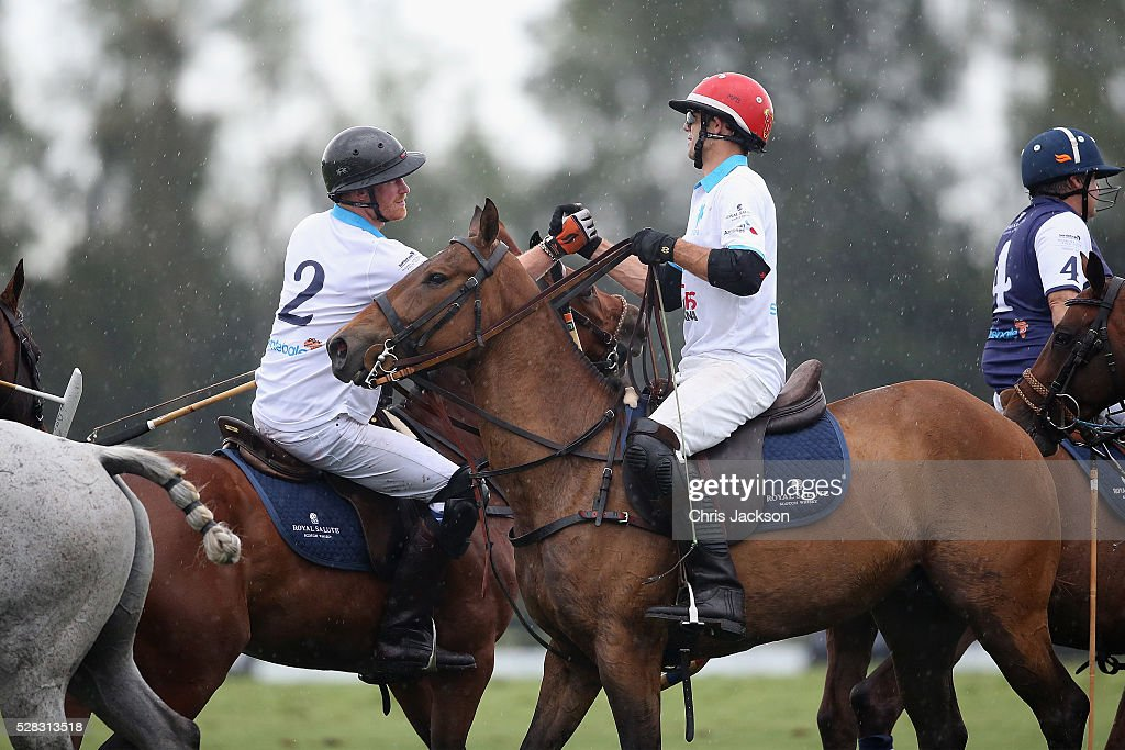 <a gi-track='captionPersonalityLinkClicked' href=/galleries/search?phrase=Prince+Harry&family=editorial&specificpeople=178173 ng-click='$event.stopPropagation()'>Prince Harry</a> (L) and Royal Salute World Polo Ambassador Malcolm Borwick compete during the Sentebale Royal Salute Polo Cup in Palm Beach at Valiente Polo Farm on May 4, 2016 in Palm Beach, United. The event will raise money for <a gi-track='captionPersonalityLinkClicked' href=/galleries/search?phrase=Prince+Harry&family=editorial&specificpeople=178173 ng-click='$event.stopPropagation()'>Prince Harry</a>'s charity Sentebale, which supports vulnerable children and young people living with HIV in Lesotho in southern Africa.