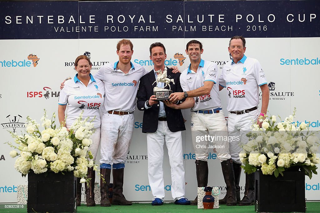 Prince Harry and Royal Salute World Polo Ambassador Malcolm Borwick pose with their team and Royal Salute Brand Ambassador Torquhil Ian Campbell, 13th Duke of Argyll after competing during the Sentebale Royal Salute Polo Cup in Palm Beach at Valiente Polo Farm on May 4, 2016 in Palm Beach, United. The event will raise money for Prince Harry's charity Sentebale, which supports vulnerable children and young people living with HIV in Lesotho in southern Africa.