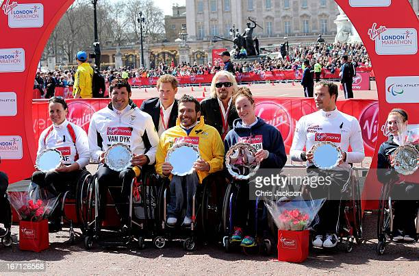 Prince Harry and Sir Richard Branson pose with the top three athletes from both the Mens and Womens Elite Wheelchair races the Virgin London Marathon...