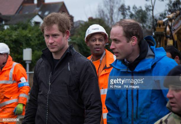 Prince Harry and the Duke of Cambridge in Datchet Berkshire as they joined colleagues from the armed forces in helping to defend the town from the...