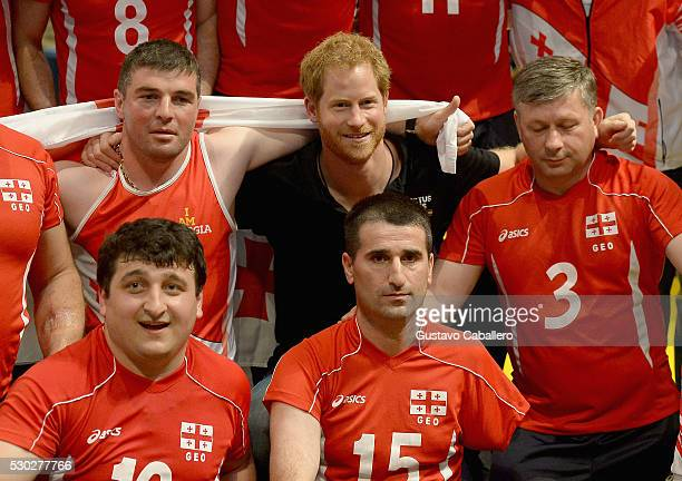 Prince Harry and the Georgian sitting volley ball players attens the sitting volleyball match between USA and Netherlands during Invictus Games on...