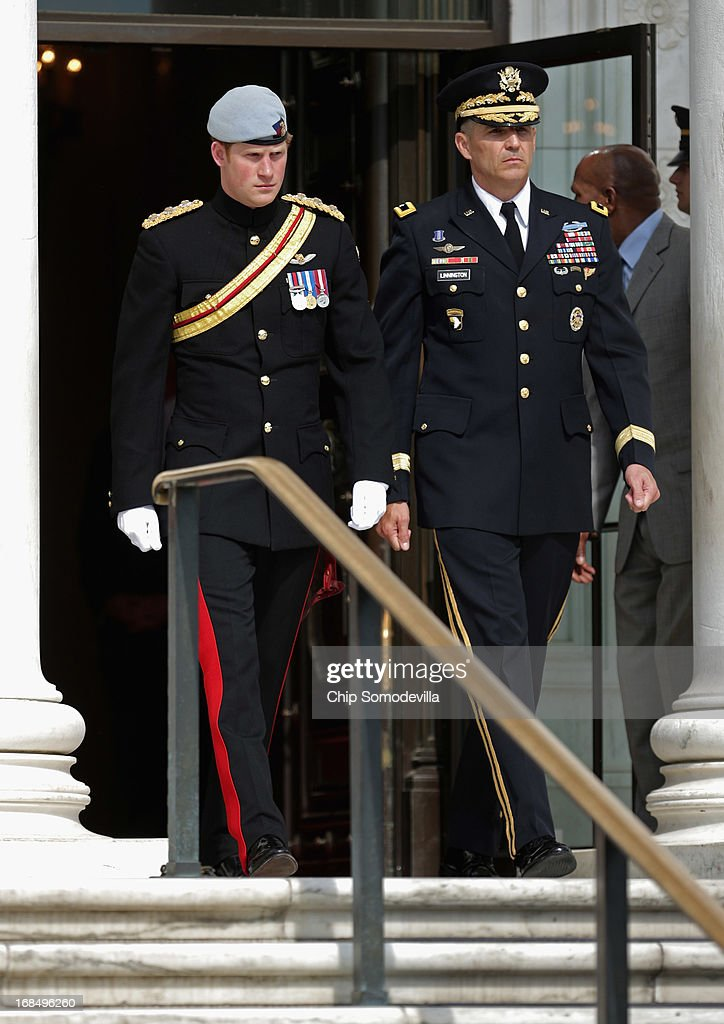 Prince Harry (L) and U.S. Army Major General Michael Linnington arrive for a ceremonial wreath laying at the Tomb of the Unknowns during the second day of his visit to the United States at Arlington National Cemetery on May 10, 2013 in Arlington, Virginia. HRH will be undertaking engagements on behalf of charities with which the Prince is closely associated on behalf also of HM Government, with a central theme of supporting injured service personnel from the UK and US forces.
