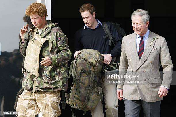 Prince Harry army officer Cornet Wales is met by his father Prince Charles and brother Prince William as he returns to Britain at Royal Air Force RAF...