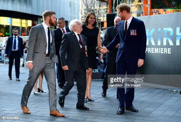 Prince Harry arrives with Dunkirk veteran George Wagner from Litchfield to attend the Dunkirk world premiere at the Odeon Leicester Square London