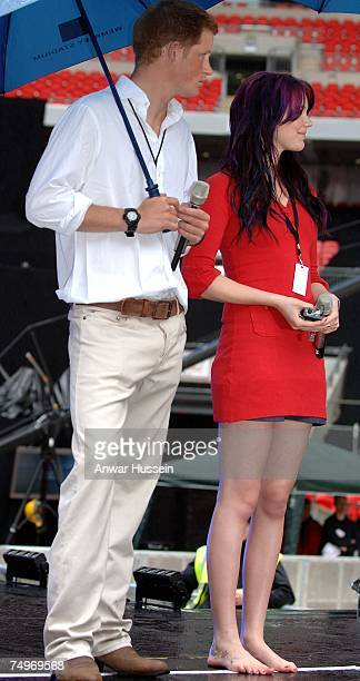 Prince Harry attends a rehearsal with singer Joss Stone who stands barefoot in the rain prior to the Concert for Diana at Wembley Stadium on June 30...