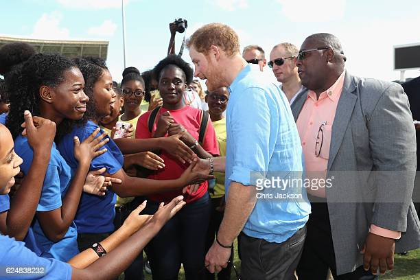 Prince Harry attends a youth sports festival at Sir Vivian Richards Stadium showcasing Antigua and Barbuda's national sports on the second day of an...