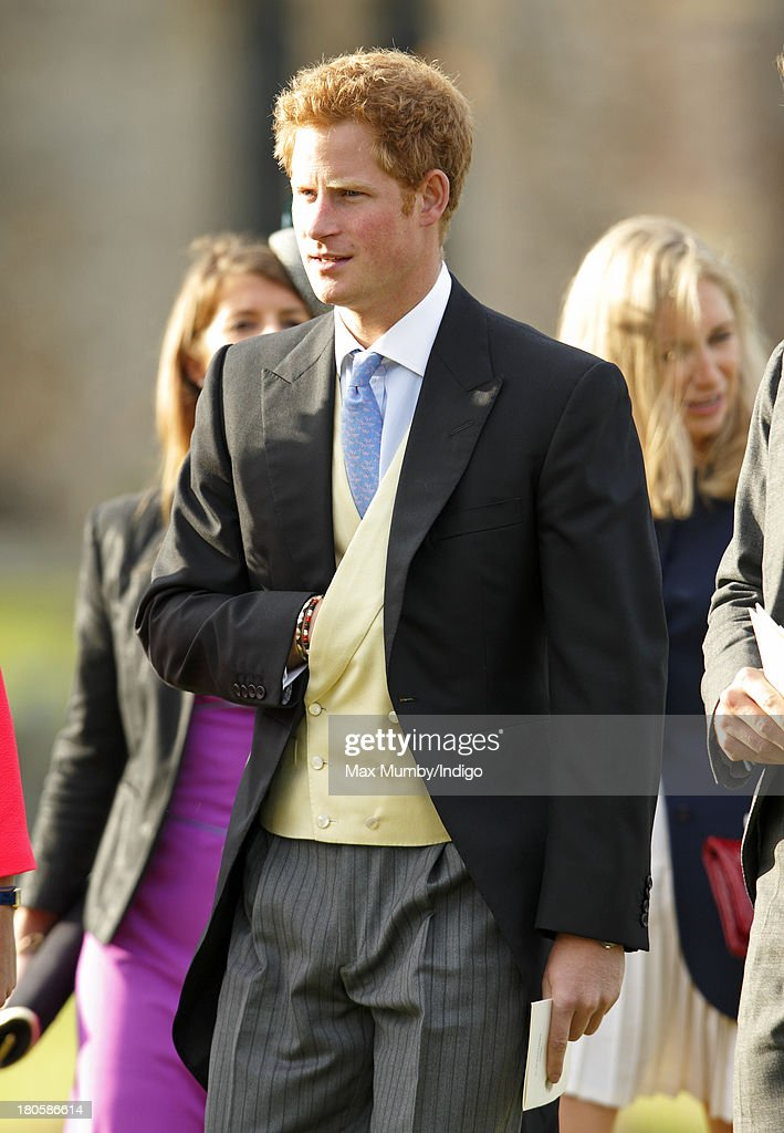 <a gi-track='captionPersonalityLinkClicked' href=/galleries/search?phrase=Prince+Harry&family=editorial&specificpeople=178173 ng-click='$event.stopPropagation()'>Prince Harry</a> attends the wedding of James Meade and Lady Laura Marsham at the Parish Church of St. Nicholas in Gayton on September 14, 2013 near King's Lynn, England.