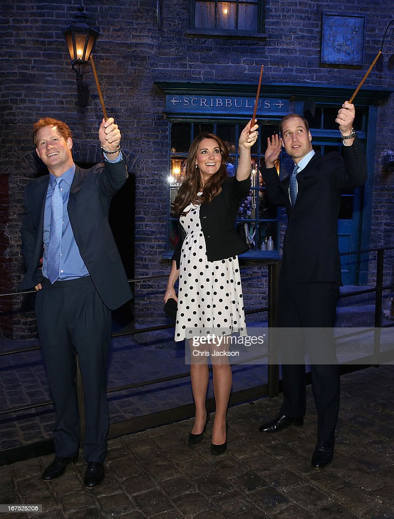 <a gi-track='captionPersonalityLinkClicked' href=/galleries/search?phrase=Prince+Harry&family=editorial&specificpeople=178173 ng-click='$event.stopPropagation()'>Prince Harry</a>, Catherine, Duchess of Cambridge and Prince William, Duke of Cambridge raise their wands on the set used to depict Diagon Alley in the Harry Potter Films during the Inauguration Of Warner Bros. Studios Leavesden on April 26, 2013 in London, England.